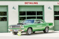 Anibal-Affiliates-GreatCarCaves-garage-with-old-mopar-muscle-car-green-and-guitar-at-gas-station